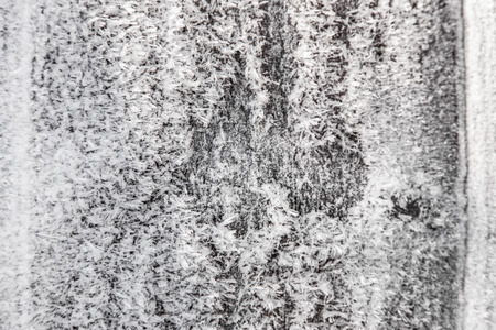 Wooden surface covered with white hoarfrost, abstract winter background, natural texture Standard-Bild