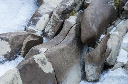 Natural stone mountain backdrop in winter time Standard-Bild