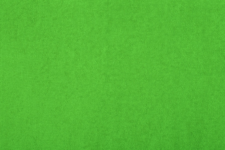 Abstract background with green texture, terry cloth fabric, full frame, close-up Stock Photo