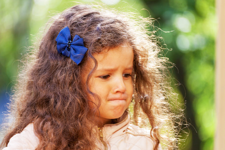 Portrait of a sad little muslim girl, outdoor, close-up Stock Photo