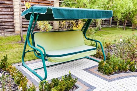 Garden Swing Sofa In The Summer Outdoors Stock Photo   100842537