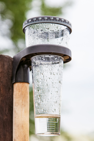 Meteorology with rain gauge in garden, measurement of precipitation 版權商用圖片