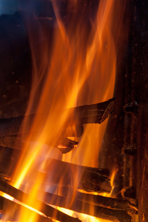 Burning firewood in the fireplace close up Stock Photo