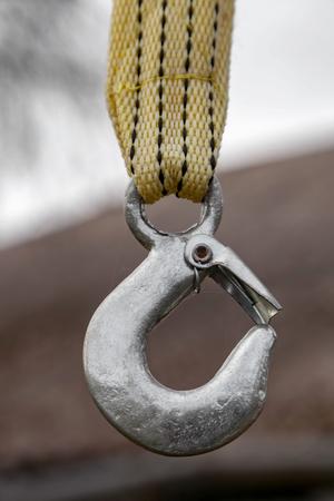 Metal lifting crane hook, outdoor, close up