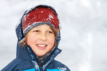 Closeup portrait of a boy in winter