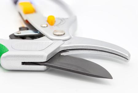 Professional garden pruner or scissors or secateurs, fragment on white background
