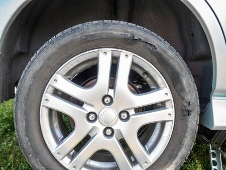 Damaged car tire with a hole after driving off-road, close-up Stock fotó