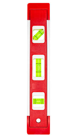 Red building level, close-up shot of Bubble spirit level for construction work, isolated on white background, clipping paths included