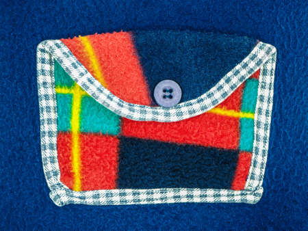 Beautiful multicolored felt children's pocket with buttons close-up as background