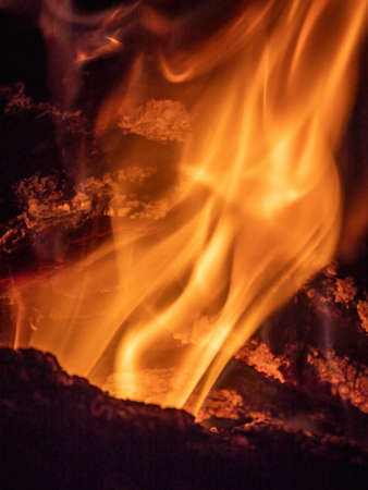 Texture of fire, burning wood in fireplace, flame abstract background, square shape
