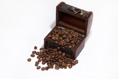 Wooden chest with coffee beans photo