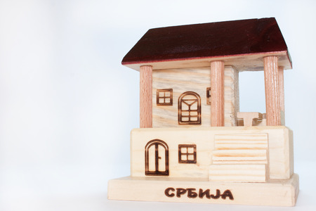 Wooden home on white background photo