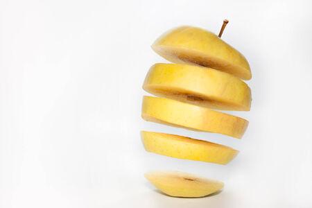 levitating: Levitating yellow apple slices