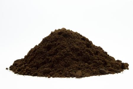 Soil in s pile on the white background Zdjęcie Seryjne