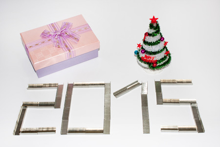 plastic christmas tree: Happy new 2015 year with staples on the white background.