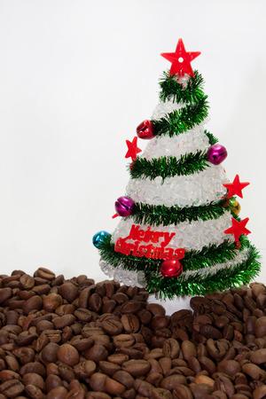 plastic christmas tree: Christmas tree on the coffee beans.