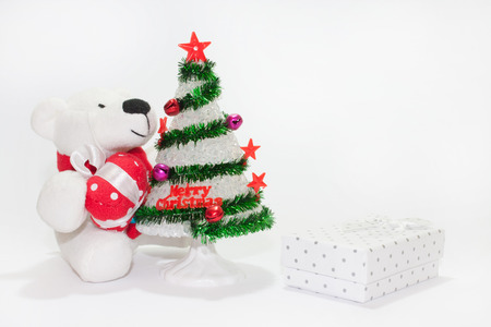 plastic christmas tree: White teddy bear with christmas tree on the white background. Stock Photo