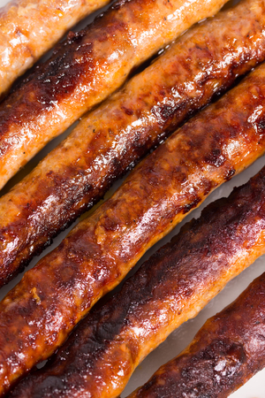 BBQ grilled domestic sausages on the plate. Stock Photo