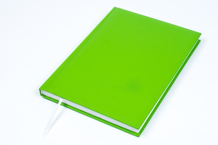Green book with empty cover page over white background Stock Photo