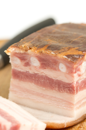 Sliced raw pork meaty bacon on the wooden board with copy space Stock Photo