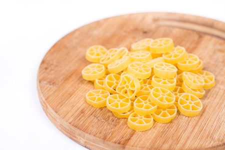 unboiled: Raw unboiled pasta on the kitchen cutting board