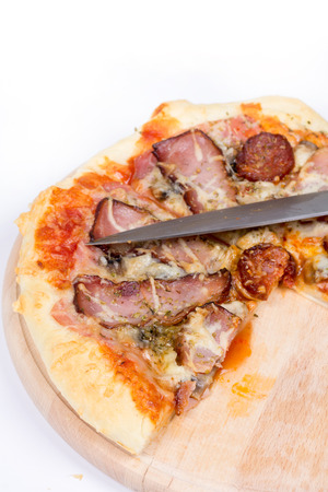 Flat lay overview of pizza with domestic ham sirloin and sausages