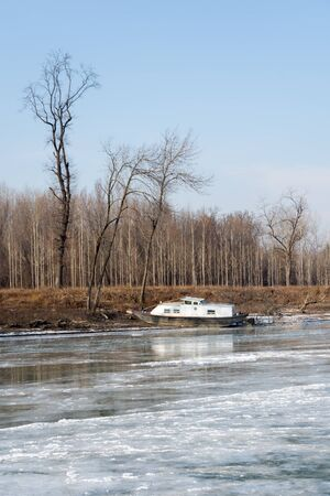 frozen river: Frozen river with forest trees and boat
