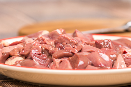 Closeup macro sliced chicken liver on the plate