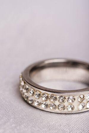 macro: Closeup macro wedding diamond ring blurred background Stock Photo
