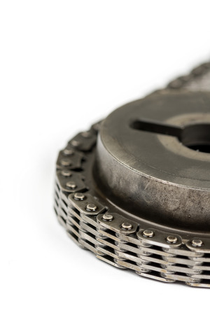 duplex: Closeup macro used oiled timing chain with cam shaft Stock Photo