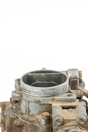 carburettor: Old dirty used carburetor isolated over white background Stock Photo