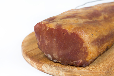 Smoked pork sirloin isolated over white background