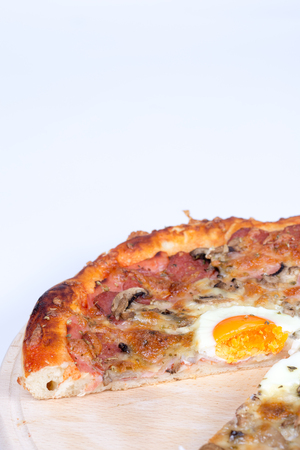 Homemade delicious pizza with egg mushrooms ham Stock Photo