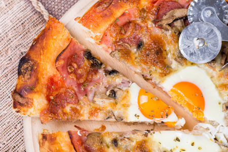 pizza cutter: Flat lay of pizza slice with egg ham mushrooms
