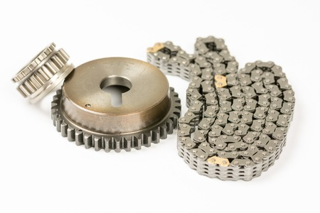 Car engine timing chain set isolated over white Stock Photo