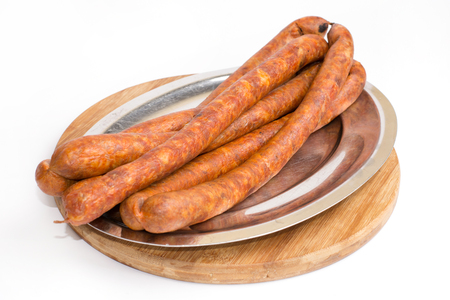 Homemade domestic red sausages on the plate