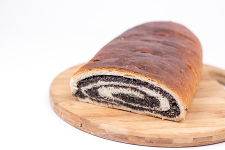 strudel: Strudel with poppy seeds on the wooden retro table