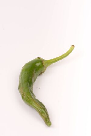 Green chilli pepper over white background copy space