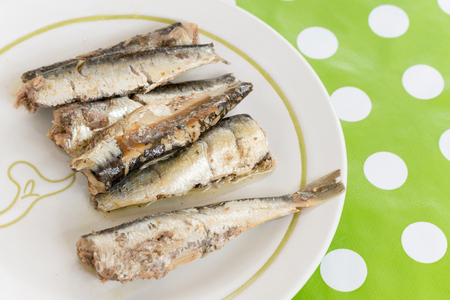 Marinated sardines served on the plate blurred background
