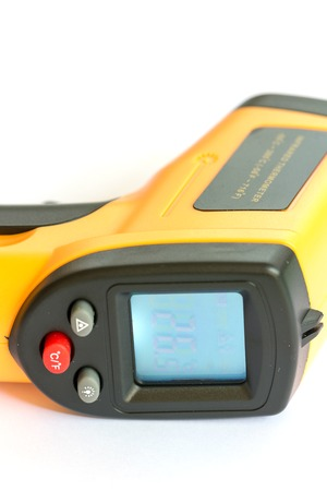 infra red: Non contact digital thermometer infra red yellow Stock Photo