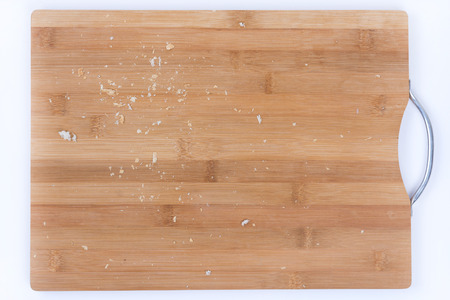 Closeup macro bread crumbs on the wooden board. Stock Photo