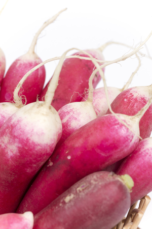 Pile of red radishes over white background. Stock Photo