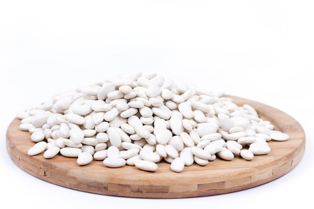 lima beans white beans: Raw white beans on the kitchen board. Copy space white background.