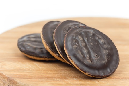 Jaffa cakes cookies chocolate orange isolated over white.