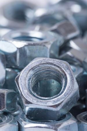 Close up macro image of metal nuts.