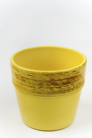 Yellow empty flowerpot isolated over white agriculture copy space