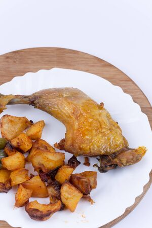 Fried chicken meat with potatoes in the plate.