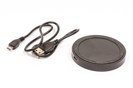 Wireless mobile charger isolated over white background.