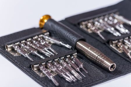 Screwdriver set in the black leather package. Stock Photo