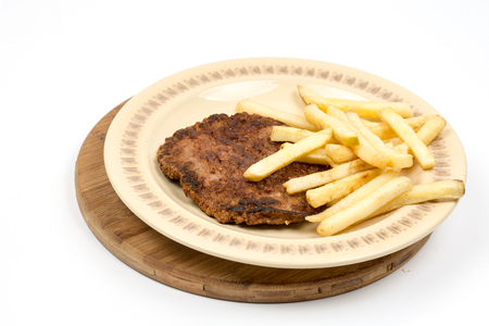 Burger with french fries served on the plate. Minced meat hamburger with potatoes isolated over white background.